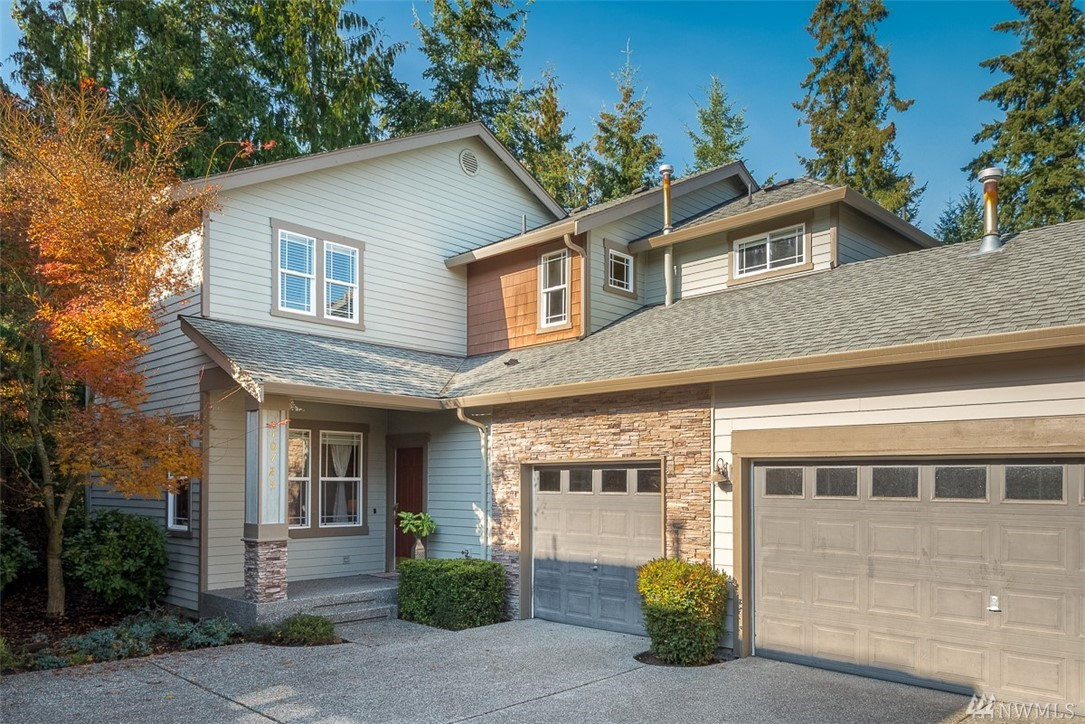 MOTIVATED SELLER. Marvelous two-story corner townhome in coveted Redmond Ridge! Tons of recent upgrades 2016/17- solid hardwood thru main lvl, new carpet new int. paint. Large kitchen w/ gas range, SS appliances, tons of cabinets and pantry. 3 bedrooms up - large master suite w/ 5 piece bath, large walk in closet. Fenced yd w/ patio, garden space. 2-car attch. garage. Only garage wall shared, low HOA, no Rental cap. Close to shops, grocery, parks. Lk WA schools. 1 yr home warranty.