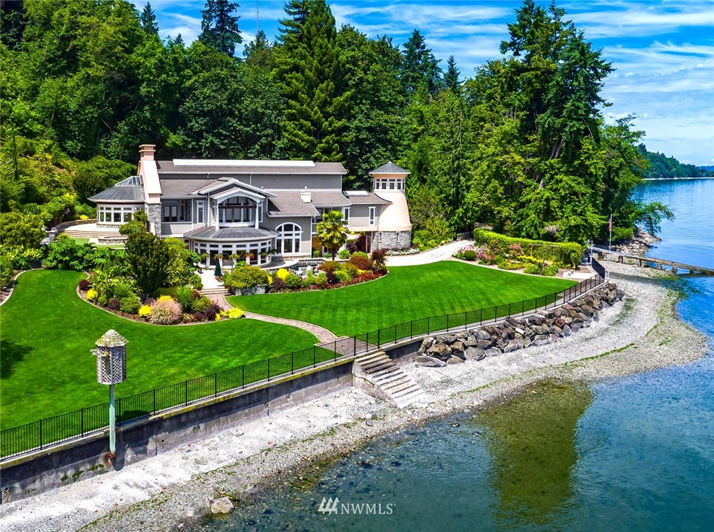Magnificent Estate on Vashon Island. Enjoy privacy and quiet at your 24 acre and ~820' waterfront estate. Spectacular views of Mt Rainier and the Puget Sound. This custom mansion will delight. The finest of details and craftsmanship throughout: Madrona hardwoods, statuary marble, and Chinese quartzite. Watch a movie in the theatre, practice putting on the green, taste wine in the wine cellar and take a dip in the hot tub. Garages for 6 cars. Boat house & ramp. Live. Enjoy. Make Memories Here.
