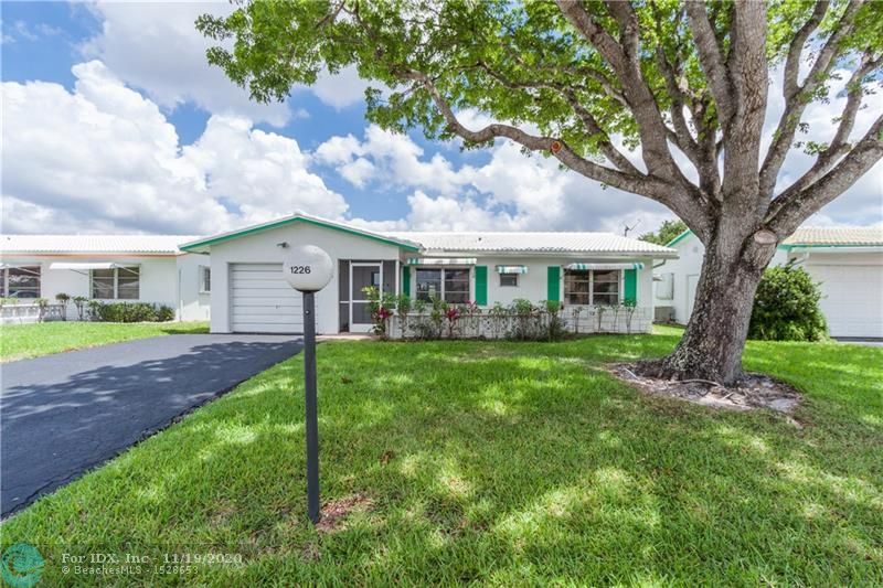 Lauderdale West Bargain!!-active adult community--must be 55 yr!  2/2 w/family rm plus Florida rm! New roof 2019!!  New flooring 2019--latest commercial grade vinyl!10 yr warranty!  A/C (both interior & exterior)less than 3 yrs old!  Washer & dryer 1 yr old! Eat-in kitchen! walk-in closets in both bedrms.  2nd bath opens to bedrm, w/additional hallway opening for guest use. Maintenance includes pressure cleaning roof annually; roof replacement on schedule; exterior painting, lawn & sprinkler maintenance.   Right across  from clubhouse & lake.   Busy Busy clubhouse; billiard room, theater, workshop, anything one might be interested in, all just steps of this home. Assoc requires 20% down payment & at least 720 credit score! on same elec grid as hospital; quick restoration from outage!