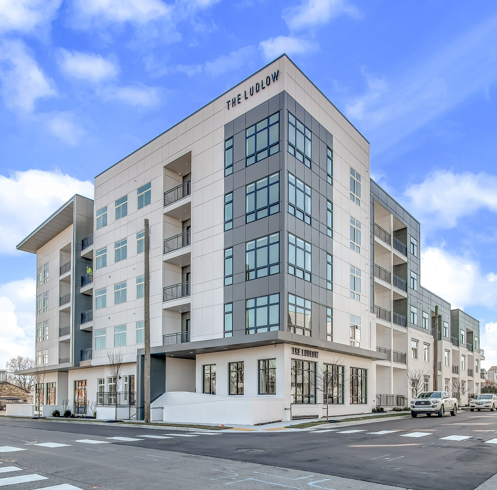 The Ludlow – 64 new construction residences. Studio, 1 & 2 bed floorplans. Sleek cabinetry, wood flooring + quartz countertops. Rooftop deck w amazing skyline views. WiFi thermostats, latch smart locks w/ Sonos speaker integration. Sales model open, building complete ready for occupancy!