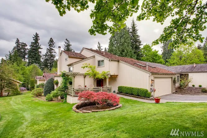 PRICE REDUCTION! Just steps to Marymoor, Microsoft and 520, this Beautiful home offers charming street appeal on a quiet Cul-de-sac.  Entertain all your friends on 2 spacious decks with custom arbors plus formal living & dining room! The kitchen delights w/granite slab, SS APPL & breakfast bar. This 4 bed 2 1/2 BA, features recent treated roof, updated Kitchen & baths, California closets, cherry floors, interior/exterior paint, New doors/windows, HOA = lawn maintenance, pool, tennis, clubhouse.