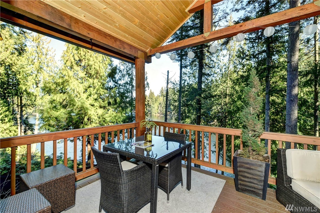 Enjoy your secluded and wooded sanctuary at private Ames Lake. Peaceful lakeside living w/50 feet of waterfront. Craftsman Style cozy 2-story retreat with fantastic lake views. Quality upgrades with deluxe Kitchen w/Center Island, Maple Cabinets, Bamboo & Travertine flooring. Remodeled Bathrooms. Lake view deck & bonus room add extra living space. Close to Redmond/Bellevue/MSFT. Sale includes County approved plans to remove code violations and replace Septic System at the buyer's expense.