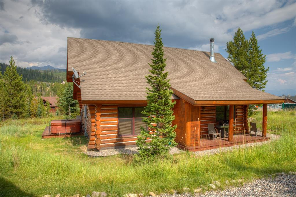 Always dreamed of owning a cozy log cabin in Montana? Then look no further than this fully furnished, ski-in/ski-out Powder Ridge cabin that offers all of the character of a cozy log cabin in the woods, combined with all of the modern amenities that you desire. This 3 bedroom, 2 bath cabin offers a vaulted kitchen/dining/living room w/ hardwood floors, a river rock fireplace, upgraded furnishings, a hot tub on the back covered porch, & a 1 car garage. This cabin is an excellent rental income producer.