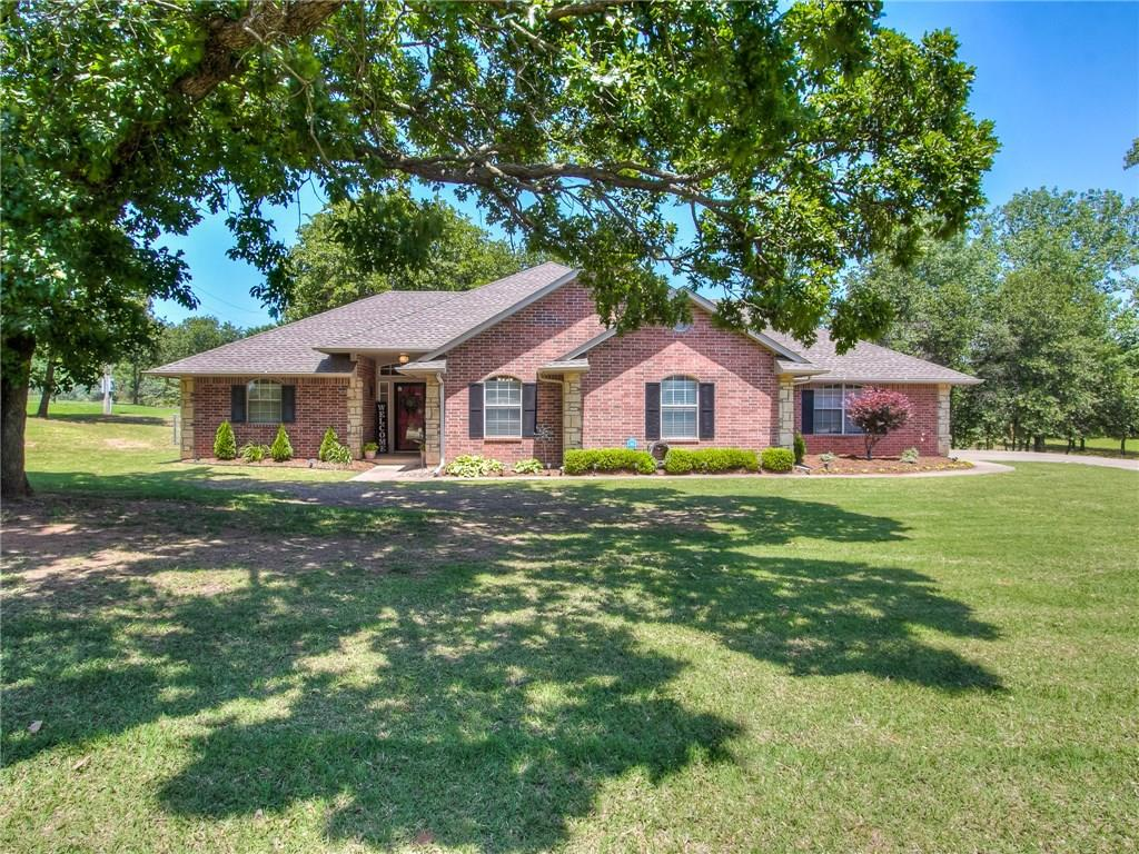 Well maintained home on acreage in Edmond with Logan county taxes and shops allowed, RUN! Home sits on a quiet cut-de-sac and offers 1.25 beautiful treed acres. Your first greeted by fresh landscaping and a nice front porch and then enter the home into a welcoming separate entry. The brick fireplace is the centerpiece of this large living room with built-in book shelves! Kitchen has been beautifully updated with granite counters, newer stainless appliances including refrigerator, and white cabinetry! Large master bedroom allowing sitting area. Master bathroom offers a large walk-in shower and separate jetted tub. 10 person storm shelter in 3 car garage. Backyard is completely tranquil with mature trees and covered patio including open deck for entertaining. Neighborhood pond with fishing allowed. New elementary school right around the corner. 3D video tour available!