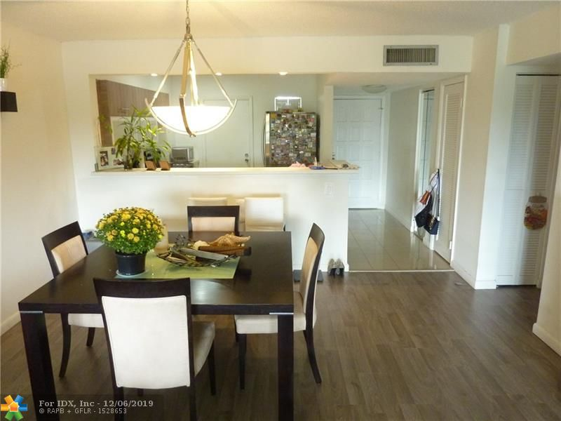 Beautifully Remodeled 2 Bedroom -2 Bathroom Condo in Falls Of Inverrary! Open Kitchen With Brand New Stainless Steel Appliances, Granite Countertops, New A/C Unit, Fully Upgraded Bathrooms! Huge Balcony and Spectacular Garden Views From This Fourth Floor Unit!