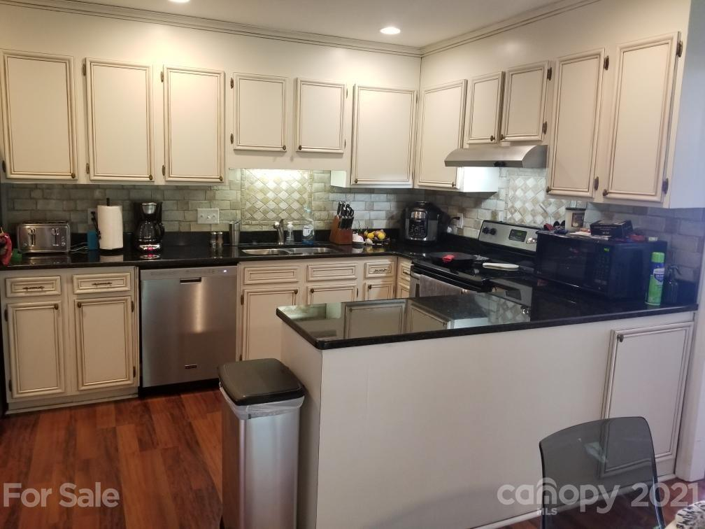 A rear ranch style corner unit. split bedroom plan, huge great room, with wood burring fireplace. Nice sunroom/workshop at rear of home, very private setting for a townhome. South Park only a few miles down the street, nice community area with pool. Intentionally priced very well.