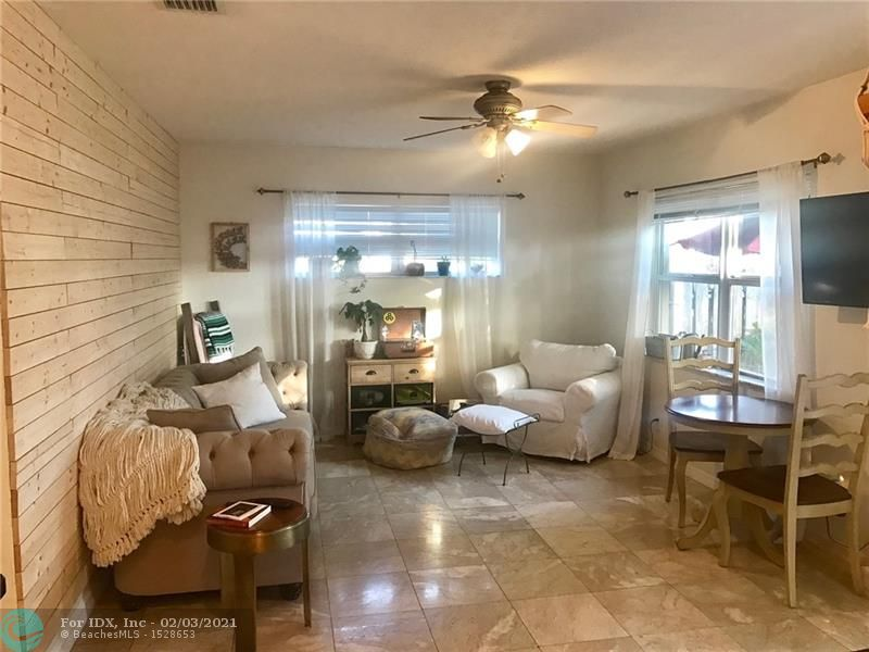 Seller offering $2,000 concessions towards buyer's closing costs. Beautiful two bedroom/two bathroom single story villa with hurricane impact windows.  Features private fenced courtyard in the front & private patio in the back.  Upgraded with granite countertops & marble floors.  Bedrooms feature walk-in closets.  W/D hookups in unit.  Assigned parking space, community pool and laundry on premise (shared with 4 other units).  Gated community with key entrance. Minutes to Wilton Manors, Ft Lauderdale's beautiful beaches, 13th Street Art & Entertainment District and Downtown Ft. Lauderdale. Property is pet friendly.  1 Assigned parking space however, deep enough to double park most regular size vehicles.