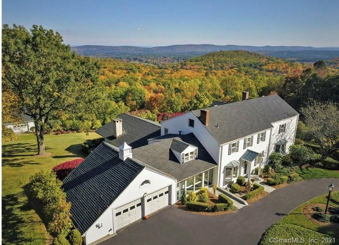 One of Simsbury's finest estates, a 5,141 sf (4 bed / 3.5 bath) sprawling colonial nestled on 6 acres of sweeping, pristine land with arguably the most breathtaking views extending as far as the eye can see!  This home offers a culmination of opulence, unmatched detail, impeccable craftsmanship and is an entertainer's delight with updated kitchen with granite countertops opening to the vaulted great room with fireplace, bar area, vaulted ceiling with wood beams and glass sliders leading to wrap around deck.  The main level also consists of formal dining room with bay window, study area with built in shelving, living room with fireplace, sitting room and full bathroom with stand up shower.   The second level of the home showcases an over sized master suite with bay window and expansive bathroom with sauna, bathtub with panoramic views of CT and separate shower.  Three additional bedrooms with full bathroom, alcove office area and walk up floored attic complete the upstairs.  Unfinished basement with wine cellar offers an ample amount of storage.  Other features include professionally landscaped grounds, two-story barn with additional garage space, circular driveway, central air conditioning and convenient location to local attractions like Talcott Mountain State Park, Rosedale Farms & Vineyards, Hop Meadow Country Club and local restaurants. Schedule your showing today and see everything 168 Westledge has to offer!