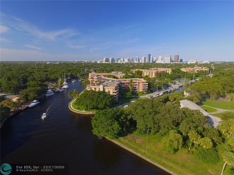 Rarely available V-shaped and largest balcony overlooking deep water, ocean access canal, pool and courtyard areas. Washer and Dryer in unit. This condo located in River Reach, a private island just minutes from major highways, beaches and downtown Fort Lauderdale FL. Boater dreams with dockage available up to 50' at the amazing fee for $3/foot/month (no fixed bridges). Unit features open floor plan, updated kitchen, large inside laundry/utility room. River Reach offers full amenities include 2 tennis courts, 3 community heated pools, club house, gym, kayaking/paddle boarding, 24h gated security, unlimited guest parking. Condo is eligible for 3% down financing. Pet friendly (2 pets under 20 lbs). HOA fee is $642/month, and is paid quarterly to the Association.