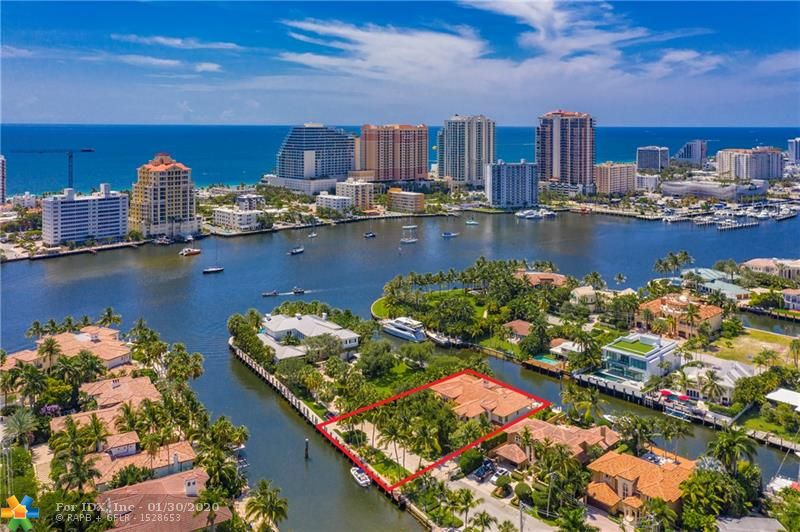 Exceptional Seven Isles estate on a PRIVATE GATED STREET w/a total of 203' of deep water frontage on 2 canals & dockage for multiple yachts. Just 1 house from the Intracoastal point! Features include water views from every bedroom, curved marble & wrought iron staircase, great room w/20' ceilings & magnificent 2-story stone fireplace, master suite w/dual baths, morning bar & sitting room. Theater, gym, elevator. Lutron lighting/smart home system. Perfect for year-round outdoor entertaining w/tumbled marble patio, vast covered area, outdoor summer kitchen & heated pool. Guardhouse at the Seven Isles entrance w/high res camera which records license plates of each vehicle entering & leaving. Walk to the beach, Las Olas dining & shopping!!
