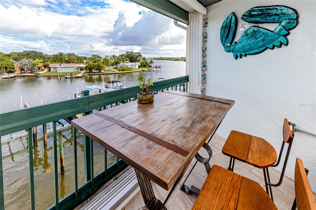 Located just blocks to the world famous INDIAN ROCKS BEACH, this 2 bd/2 ba, top floor condo has views for days! Sit and sip on your drinks, while you watch the dolphin's frolic in the intracoastal! Windward Pointe is a secluded, small, complex that consists of just 23 units. This unit is a BOATER'S DREAM with its permanently assigned boatslip, boatlift, water and electricity, ready for your day in the sun! When you step inside you would love the open concept of the kitchen/living space. This gorgeous kitchen has 42' cherry wood cabinets, large center island, convection oven, under cabinet lighting, granite counters with its large breakfast bar makes socializing easy while cooking! With the expansive living room, beautifully, updated bathrooms, indoor laundry room and tranquil master suite with views of the intracoastal, this condo can not be missed! Have we mentioned the cooled indoor/outdoor balcony? This island inspired lanai, makes you feel like you are on vacation! With a custom built entertaining area featuring a wine fridge, upright convertible fridge/freezer, and electric grill, is ready for you to kick back and relax! Amenities included; assigned, under building parking, with adjacent storage closet, resort style swimming pool, clubhouse, elevator & guest parking! Centrally located to Tampa, Downtown St Petersburg, airports and more!