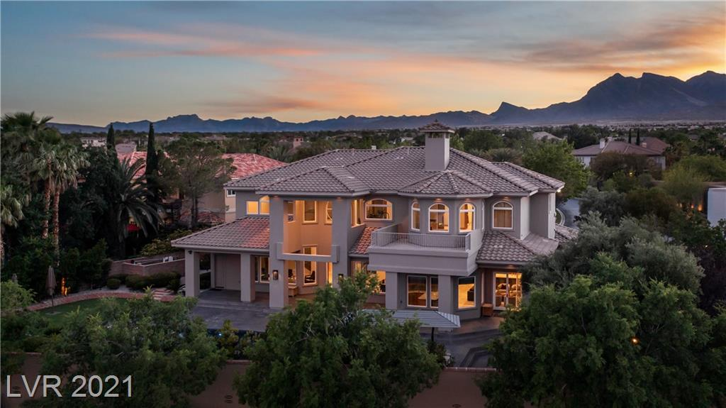 This is a truly great home in one of Summerlin's best custom neighborhoods - Mountain Trails. The home features a large entry courtyard as well as a huge backyard. It's an exceptional floor plan with very large, bright rooms and a great flow. There's a separate family room attached to a big kitchen that's filled with top of the line appliances. There's also a great dining room and living room as well as a spectacular primary suite. From the balcony there is an excellent view of the entire Vegas skyline. There's also a great office, movie theater, gym and even a fully detached guest casita. The home has been nicely updated in many places and it sits at the end of a charming cul-de-sac. All in all a great buy.