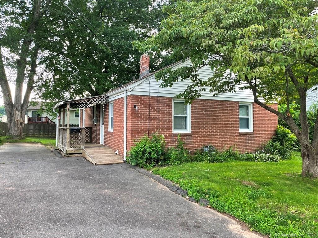 Adorable 3 bedroom 1 bath ranch.  Covered front porch with ramp.  House is deceiving from the outside.   You enter into a large kitchen.  There is a combo washer/dryer in the kitchen from the previous owner or you can bring it back downstairs.  Good size living room with access to side yard.  One of the bedrooms has a unique loft with closet space and desk.   Bring your own touches to make it your own.  Great backyard to entertain.  Lower level offers large rec room, laundry room and workshop.  Property being sold in as-is condition.