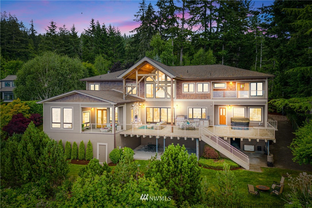 Words cannot describe this majestic Hood Canal waterfront retreat!  Regal Olympics are the artisan backdrop to a creation rich in Seabeck history, master craftsmanship, & one of a kind exquisite detail.  Gently cascading fountains awaken your senses to awe inspiring 26 ft ceilings graced by a vast fireplace & solid cherry hand crafted staircases. Palatial deck w/ outdoor kitchen, Palatial (yet intimate) owner's suite, 8 ft teak doors, mahogany trim, marble & granite baths - a dream come true!