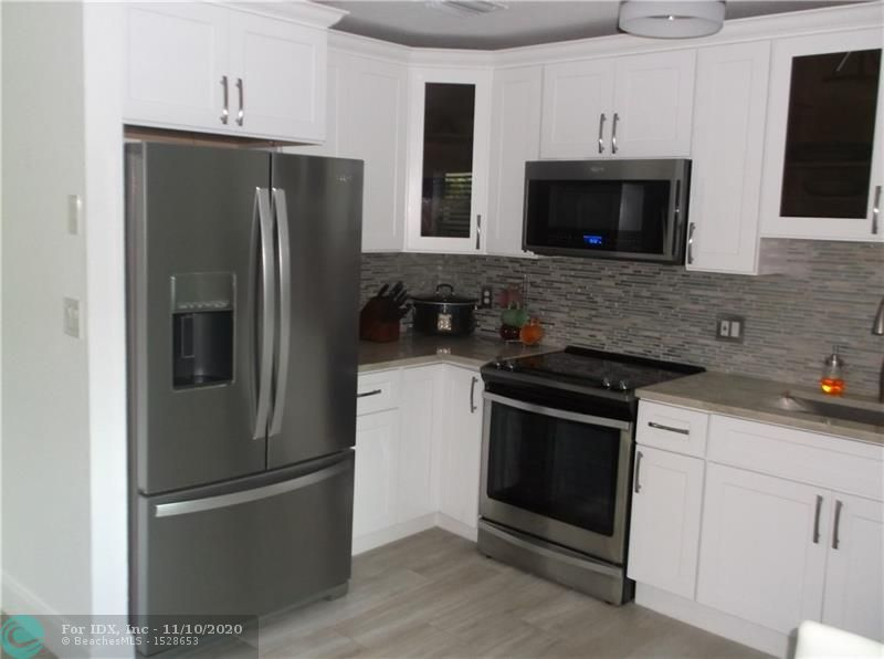 TOTALLY REDONE, THIS IS A THREE BEDROOM 2 BATH WITH EVERYTHING NEW, ALL IMPACT WINDOWS AND DOORS, PORCELAIN TILE FLOORS, WHITE SHAKER CABINETS, TOP OF THE LINE STAINLESS APPLIANCES, QUARTZITE KITCHEN COUNTER TOPS, GORGEOUS FULLY RENEVATED BATHROOMS, BRND NEW A/C, TANK-LESS HOT WATER HEATER, FENCED YARD, THIS IS AN ESTATE CASH PREFERRED, CAN CLOSE UPON COURT AND PROBATE APPROVAL, 1407 SQUARE FOOTAGE ON TAX ROLL