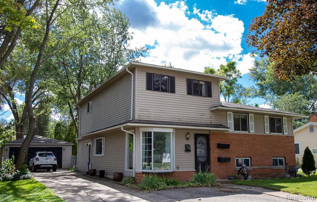 Wow! 5 bedroom home in Garden City. Home features family room with a gas fireplace and a large master bedroom. The kitchen has been partially updated with laminate flooring, stainless steel stove, and a dishwasher. Family room doorwall leads to a large deck overlooking the treed backyard. Living room is currently being used as a formal dining room. A large lower-level recreation room with daylight windows and a half bath provides extra living or storage space. Some hardwood flooring. Detached 2 Car garage. Main furnace and AC replaced in 2021. Roof is 3 years old.  Please follow all Covid-19 safety guidelines when visiting the home.