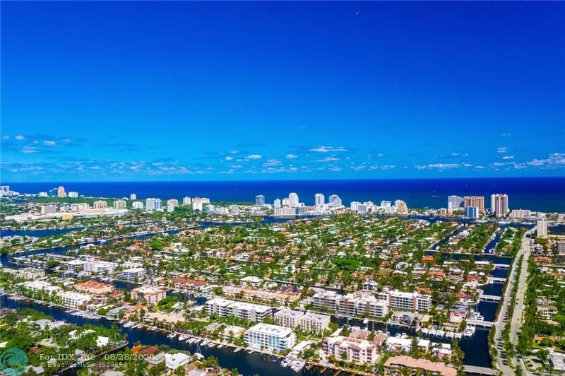 One of the very best Las Olas deep-water values under $3m! Superbly located on extremely desirable Royal Palm, underground utilities & majestic Royal Palms align the Isle. Offering one of the deepest waterways 9ft+/- & 110ft wide canal, dockage for upto 80ft. Land sales & 1950s bungalows range upto $2m endorsing value! Offering great curb appeal with high elevation,impact glass,elevator & generator. Floorplan is flexible & fabulous for entertaining, large open areas & dramatic 2 story entry with butterfly staircase. One large bedroom suite lower level, generously sized bedrooms & expansive Master Suite,spa style bath & private sitting area. Residence has abundant natural light, great covered patio, balconies & pool area.Stunning waterway views, surrounded by multi million dollar residences