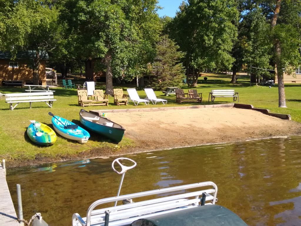 10 cabin resort, with 5 Seasonal RV Sites, 2 Transit, and 2 owner's homes. 1,258 feet of shoreline and 11.24 acres on tranquil 5 Point Lake, with conditional use permit in place for expansion. Owners home #1 was built in 2006, it is  2,332 Sq. Ft. with 3 Bedrooms and 2 Bathrooms. Owner home #2 Was built in 2004, it is 1,600 Sq. Ft. With 4 Bedrooms and 2 Bathrooms. Office/game room is attached to the home. Level elevation, sand beach, and great fishing. All this in the heart of the lakes area. Well run and cared for family owned resort. Priced to sell!