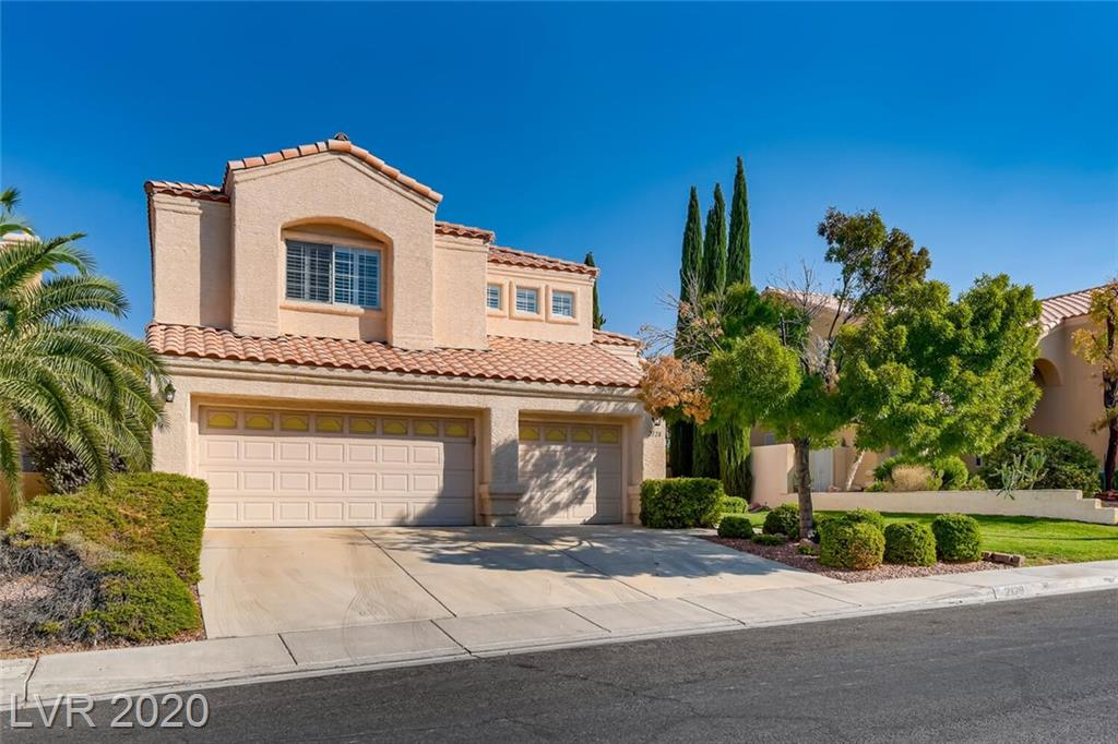 Immaculate home located in the heart of Summerlin! Surrounded by parks & walking trails. This 3160 Square foot home has 3 beds + den & office. Den has a walk in closet & can easily be made into a 4 bedroom if ever desired. HUGE primary room w/additional sitting area & 3 way fireplace. Enormous secondary rooms! Separate living & family room. Private dining area w/coffered ceilings. Fireplace in family room. So many upgrades in this stunning home. Plantation shutters, Remodeled kitchen w/all GE Profile stainless steel appliances, granite countertops, undermount sink w/bronze sensor faucet, backsplash & pendant lighting. Walk in pantry w/built-ins. Remodeled downstairs bathroom. Gorgeous high end engineered wood flooring all down stairs. Separate laundry w/cabinets and sink. Security Camera, water conditioning system. Lush landscaping in front & rear yard. 2 covered patios in rear yard. Newer A/C units and brand new water heater. True pride of ownership with this home and it stands out!