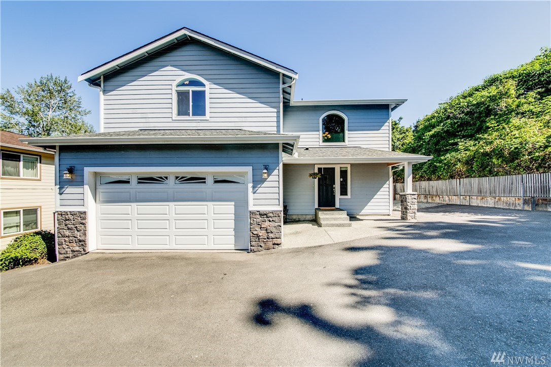 Beautiful NW Contemporary home in the heart of Milton! Spacious 2,276 sqft open floor plan features 4bed/3bath with bedroom and bath on main, master bedroom with 5-piece bath and walk-in closet, stunning Acacia hardwood floors, ss appliances, granite tile countertops, premium carpet and paint, SMART wired, Trex deck, RV/boat parking, and the list goes on. You are just a stone's throw from recreation on the interurban trail, and all that the lovely town of Milton has to offer!