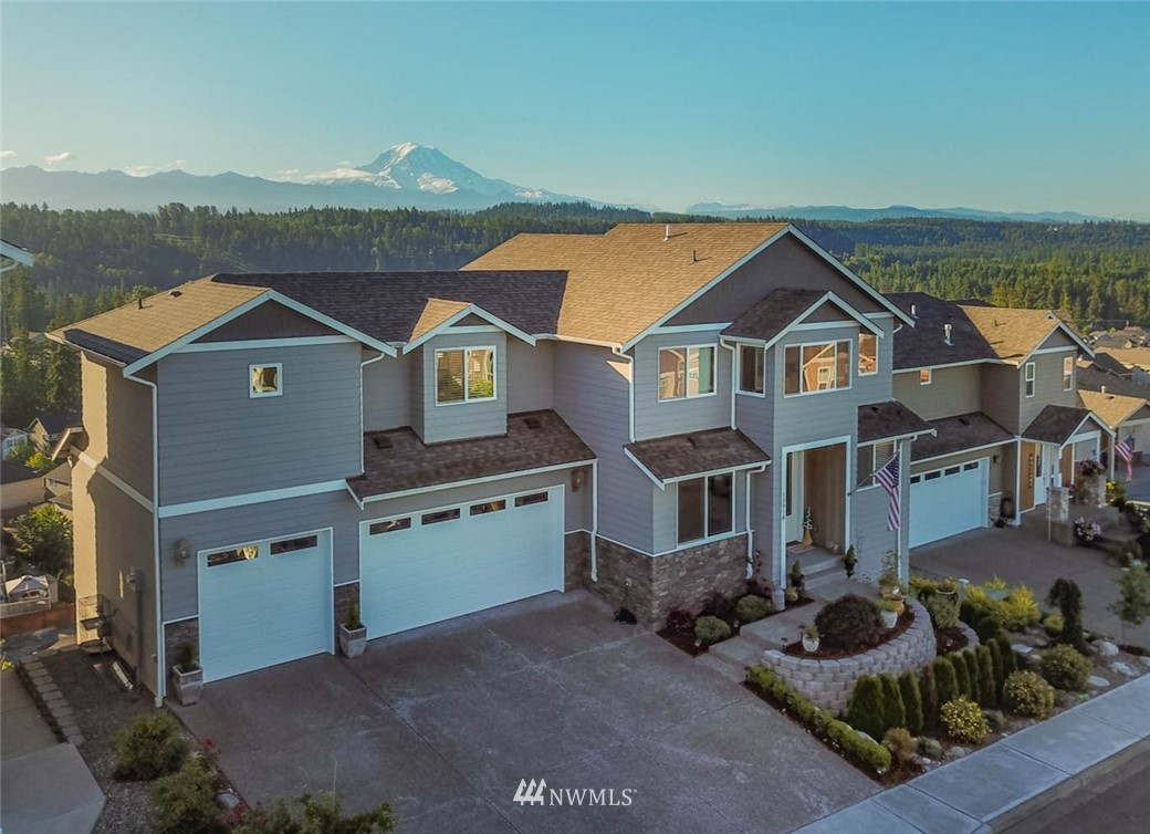 Magnificent view of Mt. Rainier and partial view Port of Tacoma! Located in highest point of Bonney Lake-Summit. Gated 43 home community, cul-de-sac, sidewalks, 2-story & fully finished basement, 3121 SF, 3-car garage, 4 bedroom, 3.5 bath, 2-master suites. Basement with own entry, living room, master suite, full bath and walk-in-closet! A/C, stainless steel appliances, granite in kitchen & all bathrooms, real hardwood floors, formal dining, den, bonus. Two decks facing Mt. Rainier with custom rear, tiered landscaping beds. Lower level is perfect for secondary MIL space / guest suite with ground level entry. Call now for a tour! This place is truly a show stopper that you have to see.