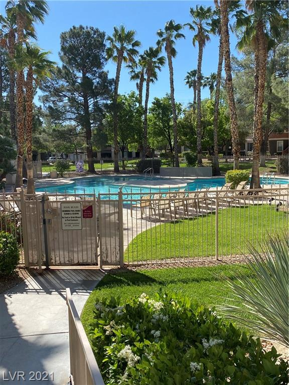 Very rare find - 3 bedroom condo on a ground floor with attached direct access 2 car garage! All appliances included! Beautiful gated community with 2 pools, gym, walking paths, and picnic areas. Designated parking area for RVs, boats, and trailers. Very accessible to freeway, shopping, Downtown Summerlin/Boca Park, and numerous dining/gaming opportunities.