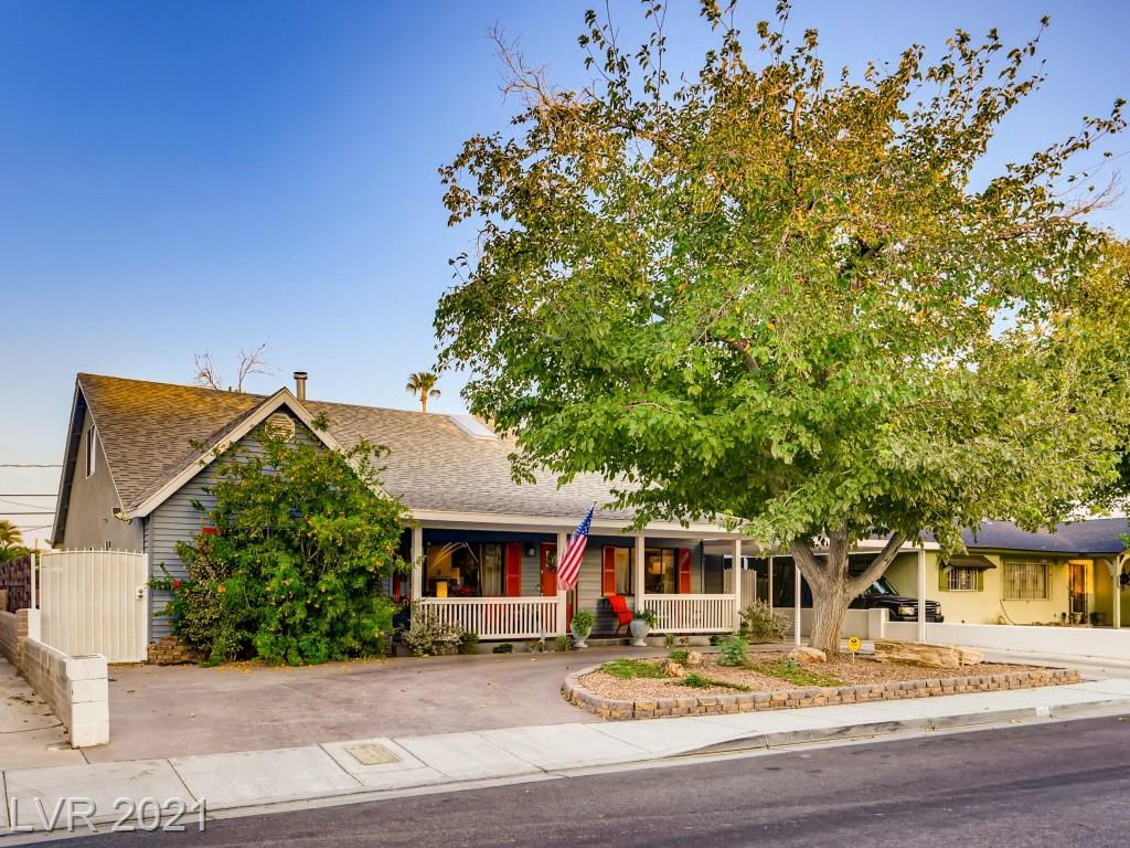 Must see STUNNING completely remodeled home in the heart of the Arts District with NO HOA. Close to the Strip, Fremont Street and all the Las Vegas amenities you could desire. This stunning home has been entirely remodeled within the last 2 years and features all GROHE fixtures! Pulling into this home you are greeted with a circular driveway and a covered porch, you'll also notice the oversized front windows. When you step in, you are met with an open floor plan, to the right you have the dining area and to the left you have the living room with a wood burning fire place. Perfect for those cozy nights in. The kitchen has been remodeled and features an oversized island with seating for 4. Granite countertops and custom cabinetry throughout. Upstairs you will find an over sized loft with skylights, great for a game room, loft or den. The bathrooms have been remodeled and feature tile showers, floors and granite counters. The master bathroom is fit to be luxury spa, with wet room.