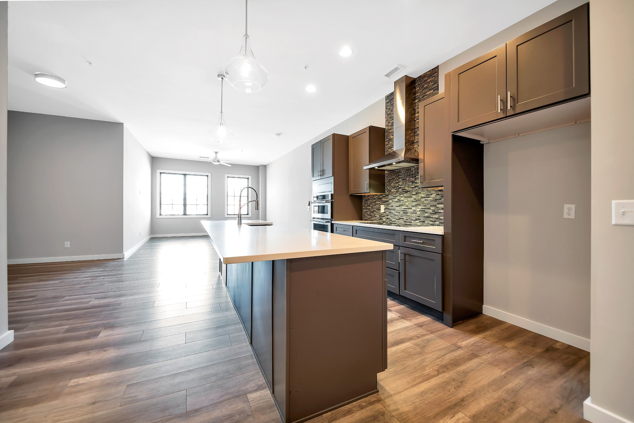 One of a Kind, new condo in downtown Brentwood. Everything is within walking distance! Large penthouse w/ quartz countertops, induction cooktop & more. Tankless water heater, Pella windows and doors. Shared Elevator. Great Live/Work opportunity! Retail space available for lease on first floor. Also for lease $3750 per month