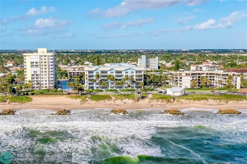 """RARELY AVAILABLE PENTHOUSE RESIDENCE IN DEERFIELD BEACH'S PREMIER BUILDINGS.  INTERIOR BOASTS APPROXIMATELY 2300 SQ. FEET OF AREA FEELS LIKE HOME AND OFFERS GORGEOUS 24X24 TRAVERTINE MARBLE THROUGHOUT, OPEN KITCHEN W/42"""" HONEY WOOD CABINETS, GRANITE COUNTERS, STAINLESS STEEL APPLIANCES INCL. SUBZERO REFRIGERATOR.  EXTREMELY SPACIOUS MASTER SUITE COMPLEMENTS STUNNING DIRECT OCEAN VIEW & DESIGNER MARBLE BATH, WALK-THRU SHOWER, SEPARATE STAND ALONE TUB, AND PRVATE COMMODE & BIDET. PENTHOUSE FEATURES 11' SOARING CEILINGS & SKYLIGHT IN MASTER BATH.  FANTASTIC AMENITIES INCL. COURTYARD STYLE COOMON AREA W/PLENTY OF LOUNGE CHAIRS ARD. HEATED POOL, JACUZZI, & SITTING AREA OUTSIDE OF THE POOL, TWO GAS GRILLS, UNDERGROUND PARKING, TREMENDOUS GYM, SEPARATE STEAM ROOM AND SAUNA.  PARADISE DOES EXIST!"""