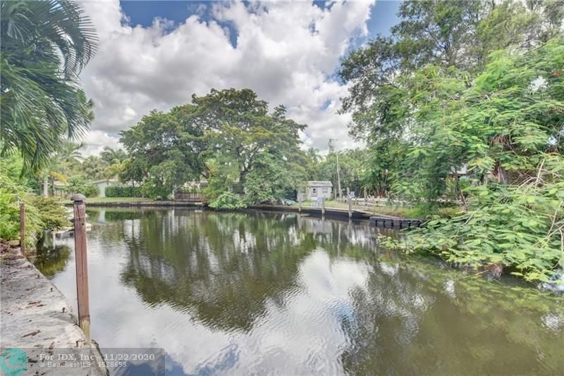 JUST LISTED! AMAZING CANAL WATERFRONT HOME WITH OVERSIZED FENCED PRIVATE YARD. TROPICAL GARDENS ABOUND THIS PROPERTY. BRIGHT AND SPACIOUS. WATER VIEWS FROM FLOOR TO CEILING WINDOWS IN FAMILY ROOM, DINING, LIVING ROOM AND MASTER BEDROOM. 3 BEDROOM/2 BATH. OVER 2,000 SF OF LIVING SPACE. UNIQUE FLOOR PLAN. FORMAL DINING ROOM WITH FRENCH DOORS LEADING OUT TO PRIVATE PATIO. QUIET CUL D SAC W/ LARGE DRIVEWAY AND CARPORT. MANY UNIQUE DESIGN FEATURES. UPDATED KITCHEN. MASTER BEDROOM HAS SEPARATE SITTING AREA AND AND BUILT IN CLOSETS. NEWER ROOF, AC AND PLUMBING. PRICED TO SELL 'AS IS'.