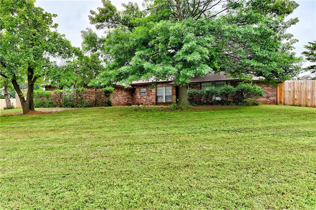 Beautiful updated acreage in the country close to shopping, restaurants & schools. Your buyers will love this ranch style home that's sitting on 1.45 acres with a new wooden privacy fence! Updates includes kitchen cabinetry, counter tops, appliances, bathrooms, new flooring both wood, tile, carpet, fresh paint plus recent heat and air. Home is roomy w/4 spacious bedrooms, living room with fireplace, bookshelves, bar with a sink, and has a beautiful view of the backyard and pool. The covered deck is 60' long by 14' wide perfect for large family gatherings. The large master bedroom with his/her closets, whirlpool tub, shower and and access out to the large covered patio. The oversized heated garage has ample space for storage and features a storm shelter.  The 30x60 shop with LED lighting is equipped with a heat pump and air which is perfect for your RV, hobby or add'l living space!  $100000 addition. Horses allowed! Show MLS#848329 to your buyers to see the before and the after updates!