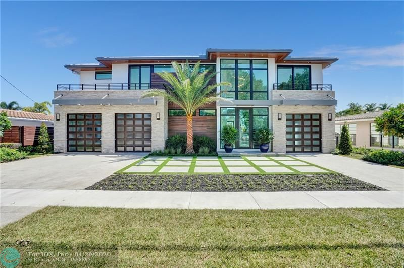 Breathtaking from the moment you arrive, this 5 bedroom, 5 and 2 half bath waterfront, one of a kind glass home by award winning architect AZD. The gourmet kitchen boasts Wolf appliances to include a gas cooktop, coffee system, and a SubZero refrigerator. Other custom features include 48 x 48 Italian porcelain tile, Lutron lighting, an elevator, a climate/humidity controlled wine wall with LED lighting, 2 gas fireplaces, complete closet systems, 3 bay garage, 4 zone AC, walk-in pantry, and 2 laundry rooms. The home has a new concrete dock to include water and 50-120 amp electric service and new seawall and pilings. This smart home has been equipped with the Control 4 Automation System. Ask for more information! VIRTUAL TOUR WITH LINK: https://my.matterport.com/show/?m=GAZMJqckfp7&mls=1