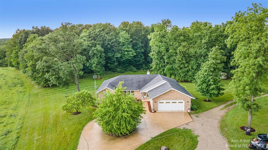 Welcome Home to this 5 Bed (1 non-conforming), 3 Full/2 Half Bath, just under 3500 total finished sqft brick ranch on over 16 acres with a 98 X 54 Morton Barn w/ 16ft Doors!! Completed in 2001, this ranch home features a grand living space combining the living room, dining and kitchen. Open up the doors to the massive deck overlooking the backyard and you now have a one of a kind space for friends and family. The main floor layout is ideal with the master bedroom on its' own side of the home with the two other bedrooms on the opposite side. Laundry on BOTH levels! Head downstairs and you'll notice a large living space with walkout, full bathroom and 2 additional bedrooms (1 non-conforming).  Don't forget about the hot tub! 20 minutes to Saline and around a half hour to Ann Arbor! If you're looking for a modern layout brick ranch with space to grow and an out building that truly shines, than this is your place!! Hurry before it's too late!