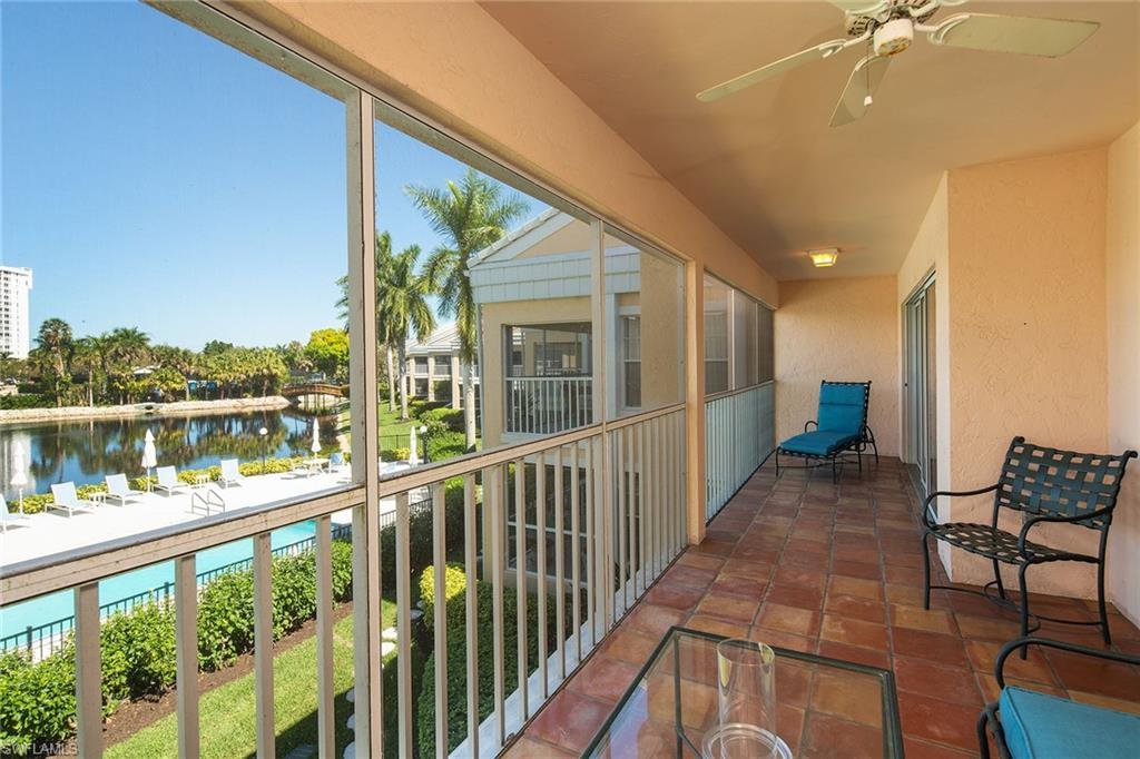 Relax and enjoy the sparkling lake, preserves filled with wildlife, sizzling sunsets and the newly updated warm water pool. The nearby footbridge leads you to the waiting tram to carry you to the beautiful sandy beaches of Pelican Bay. Dine at the Gulf-side restaurants or directly on the beach. This home is offered turnkey furnished and ready for your Naples lifestyle. Vaulted ceilings add to the spaciousness of this 2-bedroom retreat. The eat-in kitchen features a desk area, granite countertops and open views to the dining room and living room out to the water. Enjoy a refreshing glass of wine from your own wine cooler. Tiled throughout in addition to the large screened balcony. Walk-in custom closets, Florida-style, ready to move into now.