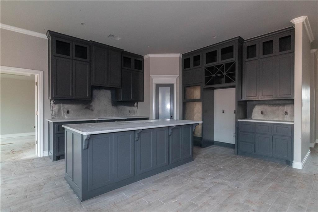 This Hazel Half Bath floor plan includes 2,225 Sq Ft of total living space, which includes 2,000 Sq Ft of indoor living space and 225 Sq Ft of outdoor living space. There is also a 570 Sq Ft, three car garage. Home includes 4 bedrooms, 2 full bath, and a half bath. Living area includes a gorgeous corner fireplace with stack stone surround, 3 7ft  windows, and barn door! Kitchen has an oversized island, 3CM quartz tops,  stainless steel appliances, decorative tile back splash, and a corner pantry. Master suite features a boxed ceiling detail with crown molding and bathroom featuring separate vanities, large walk in shower, whirlpool tub and spacious walk in closet! Master closet has a connection to the utility room! The exterior of this house has fully sodded front and back yards with in ground sprinkler systems. Covered back patio with outdoor fireplace. Home has  Smart Home Technology, Rinnai Tankless water heater, whole home air purification system, R-44 insulation and Solarboards.