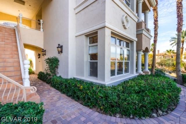 Gorgeous condo in heart of Lake Las Vegas within the community of South Shores Golf Villas on the 10th hole.  Corner unit with beautiful panoramic views.  Highly upgraded, subzero fridge, Wolfe range, marble flooring, upgraded cabinets, fireplace in living room, stained glass windows, covered patio off master and kitchen. Guard gated.
