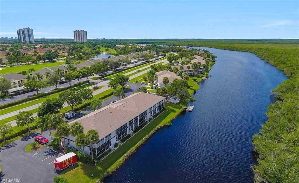 WOW! ALL NEW INSIDE WITH SHAKER STYLE WHITE CABINETRY, GRANITE COUNTERS AND STAINLESS APPLIANCES. ALL NEW BATHROOMS TOO IN THE SAME STYLE FOR CONTINUITY AND DESIGN. GORGEOUS NEW ENGINEERED HARD WOOD STYLE FLOORING THROUGHOUT. SIT ON THE LANAI AND ENJOY THE FABULOUS RELAXING AND TRANQUIL WATER VIEWS. AMENITIES INCLUDE TROPICAL STYLE POOL AND TENNIS COURTS AND PICKLE BALL COURTS. LOCATION IS PERFECT CLOSE TO MARCO ISLAND AND HISTORIC DOWNTOWN NAPLES 5TH AVENUE.