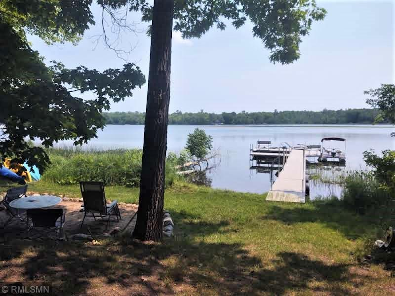 Once in a lifetime opportunity to have it all. Borden Lake Retreat 25.62 acres of pristine rolling hills with groomed trails, abundant wildlife and 4 permanent stands. 200ft of lakeshore, consisting of 50ft with beach, dock, storage shed at the waters edge, along with 150ft of undeveloped lakeshore. 2 br 1.75 bath year round cabin with a walk out basement, deck, balcony, outdoor shower and hot tub are just some of the features there to enjoy. Tranquil gardens, and landscaping surround the cabin, plus a 20X40 garage with 11X38 attached guest area with ½ bath, RV pad with 50 amp service, 30X30 pole building with overhang.  Picture 11 is currently being used as a 3rd bedroom, but in the measurement section is called utility room.  Drilled well and compliant septic. Raspberry Lane is a private road.