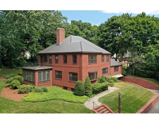 Experience the warmth of this beautiful Center Entrance Brick Colonial home with over 3,700 SF of living space filled with abundant natural light, high ceilings, hardwood floors and lovely period details. 7 Tyler Road sits on close to half an acre of private land.  This 11 room, 5 bed, 5.5 bath, home stands stoically above the street, nestled among gorgeous mature trees and plantings with beautiful brick and stonework surrounding the property and leading to front entrance.  Conveniently enter home from attached 2 car garage directly into mudroom to family room.  Belmont Hill  is located in the northwest corner of town, in an exclusive area with numerous majestic properties. Good commuter location: public transportation to Alewife T Station: easy access to all highways throughout Metro Boston area, approx. 5 miles to Boston Proper.  This elegant home is perfect for entertaining and for a growing family to create wonderful memories.  Virtual information on TOUR icon above.