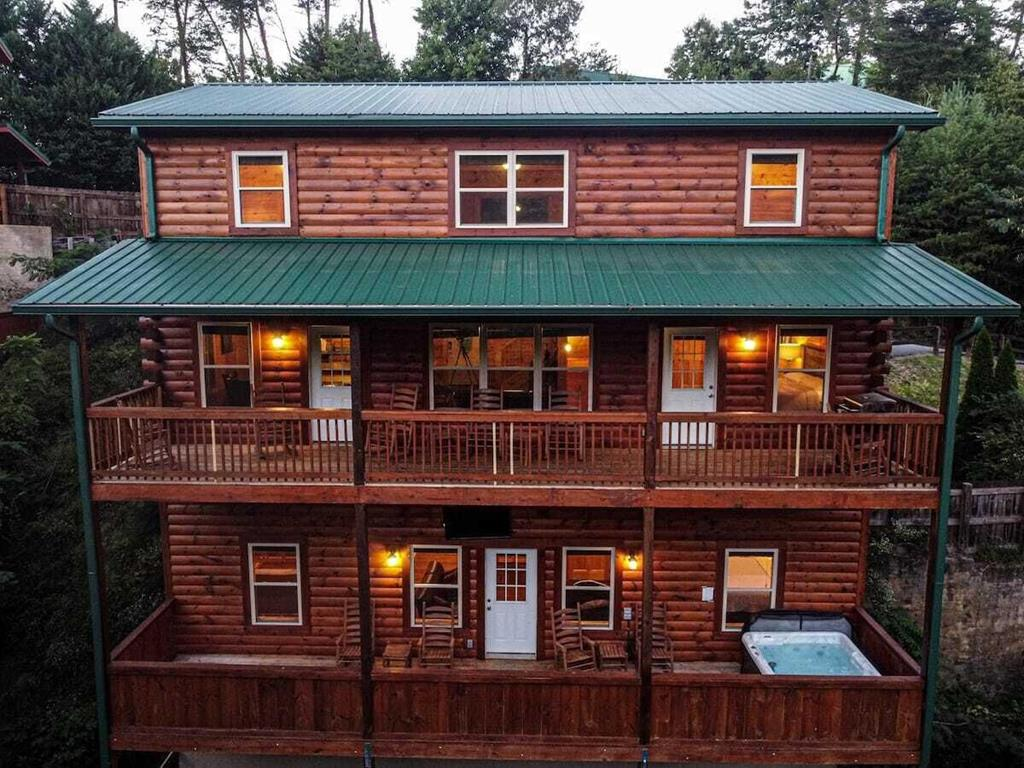 Must see 5 bedroom/5 bath INCOME PRODUCING cabin right off the Parkway in the heart of Pigeon Forge. Built in 2019 and meticulously maintained, this cabin is completely turn-key with a huge hot tub, pool table, foosball table, 2 living rooms, 8 TVs, and both gas and charcoal grills. The kitchen is fully equipped with service for 16 and a brand new set of pots and pans. 2020 gross earnings at $108k and on track for $132k for 2021 - don't miss out on this investment opportunity! Decks were stained in November 2020. Private driveway can hold 3 cars plus 2 additional designated parking spots across from the cabin.  UPDATE: Multiple offers - please submit final offers by Monday, 6/7 at 6pm.