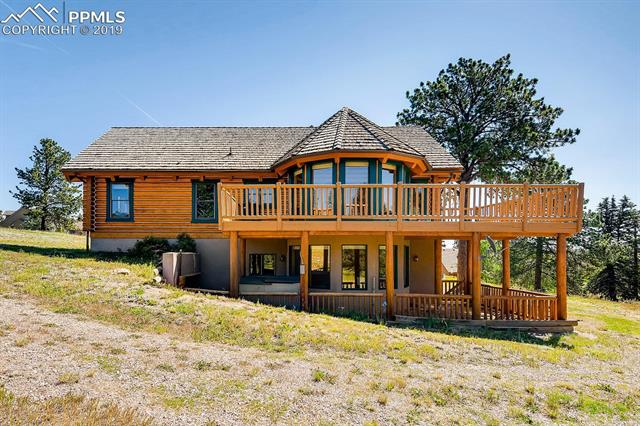 """Stunning custom Colorado log home. 9"""" Swedish cope log home with Pikes Peak view, located at the end of a cul-de-sac and only 6 minutes from the heart of Woodland Park. From the moment you walk into the great room you will not want to leave. Oversized main level master suite with a sitting area, attached 5 piece bathroom and large walk in closet."""