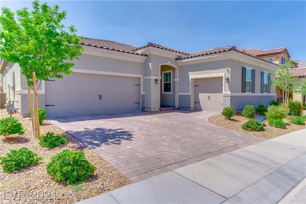 WOW....that's all I can say about this home. Single story, 3 car garage, pool, no rear neighbors, gated neighborhood in Inspirada.....this home has it all. Open floorpan, plantation shutters throughout, surround sound (even outside), modern kitchen with custom white cabinets, walk in pantry, custom pendant lighting, tankless water heater, covered back patio, salt water heated pool, and beautiful views.....this is a MUST see home!