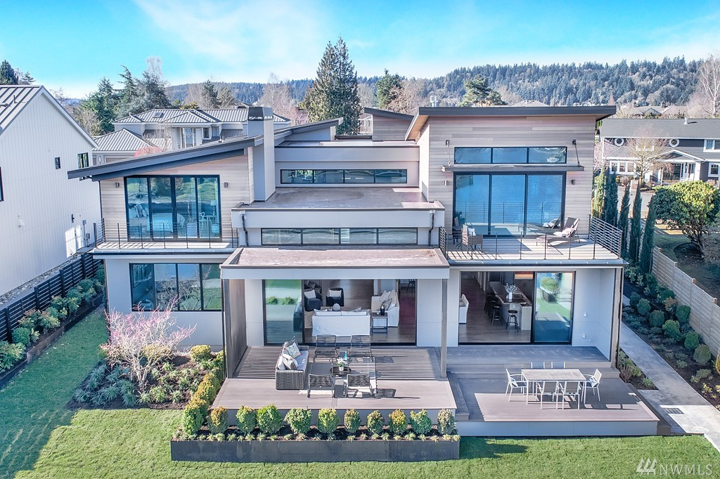 Exquisite new construction on the water in coveted Newport Shores, with a Zen feeling. Entry opens to the views the moment you walk in.Great room & kitchen are stunning & flow to the huge deck & moorage.Fireplaces with custom metal & finishes are a work of art.Kitchen boasts the best appliances & a living edge counter.Dining room with handblown raindrop lighting. Media room, guest suite & den. Serene master with deck. Gorgeous finishes, doors &lighting. Built by MacPherson Construction & Design.