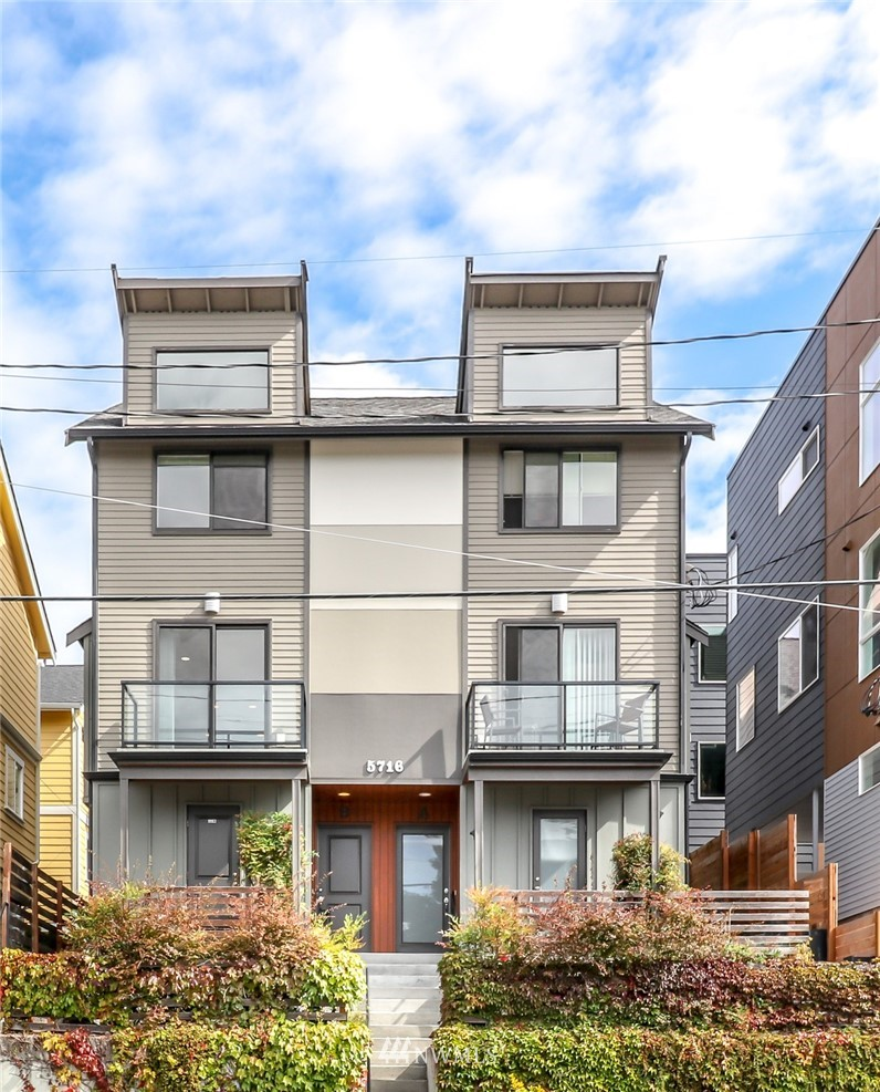 Great layout in this well situated townhome, (no HOA) with easy access to UW, downtown, Roosevelt shopping and the light rail station opening Oct. 2nd. Alley access to secure one car garage. Bamboo floors. Radiant floor heating in top 2 levels. Gas fireplace. Full sized washer and Dryer.  Sits high up off the street. Lots of natural light throughout. Easy bike ride to Greenlake, Cowen park UW district. $3,000.00 credit for new appliance package!! Please note that the property is virtually staged