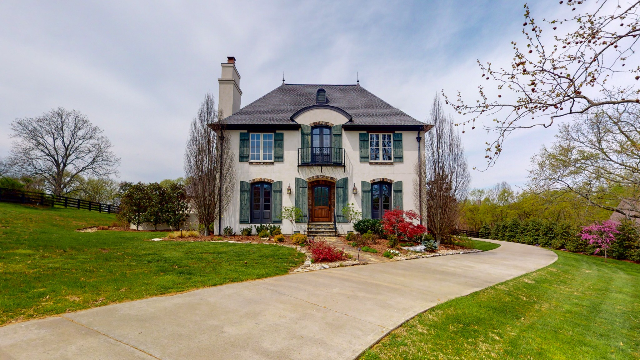 French Country Estate on 3.39 acres. Country setting 12 min to Cool Springs. Beautiful kitchen w/ separate fridge  and freezer. Walk-in pantry. Butler's pantry w/ ice machine & wine fridge. Master suite w/ vaulted ceilings, marble shower, & freestanding tub. Large bonus room. Oversized rooms. Thoughtful, open floor plan. Ideal for family gatherings & entertaining. Hardwood floors throughout. Wide, arched doorways. Resort pool w/ outdoor fireplace. Wine porch. Rain garden. Fenced-in backyard.