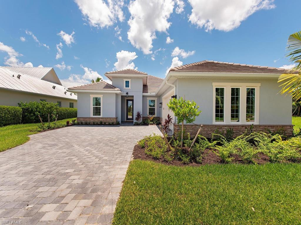 "This gorgeous brand-new coastal inspired home by Ashton Woods is located on the lake in Sparrow Cay. Inside you'll find a sunny, bright, open kitchen and living room with plenty of upgrades such as beautiful 42"" white shaker style Wellborn kitchen cabinets, all stainless steel Whirlpool appliances including 36"" cooktop, refrigerator, washer and dryer, walk in pantry, white tile backsplash, and enormous granite counter-top island perfect for gatherings. Main living space features 7x22 wood look tile and the bedrooms feature upgraded Shaw stain resistant carpet for comfort. Relax in your private pool or under your covered lanai. Other notable features include impact windows throughout, rain head and frameless doors in master shower, tray ceiling in master bedroom and 10 year limited structural warranty! In this exclusive gated community, residents can enjoy community clubhouse, pool, fitness center, lakeside beach, lap pool, social membership at Walkers Hideaway Marina and more. Our power house green package double pane windows with screens, digital programmable thermostat, 50-gallon water heater, 15 SEER HVAC system and more. Schedule your appointment today!"