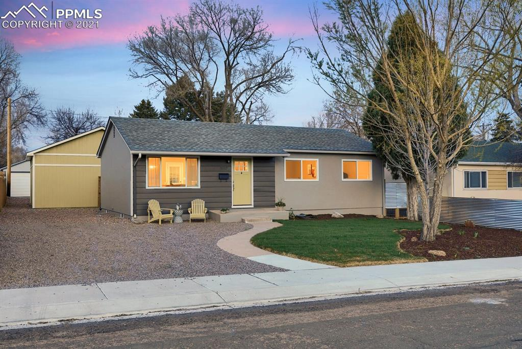 Fabulous centrally-located rancher with Pikes Peak VIEWS!! This home features 3 bedrooms, 1 bathroom, partially-finished basement with room to expand, an oversized 2-car garage w/electric subpanel, storage shed, RV parking, extra off-street parking, and a newly-landscaped yard! Remodeled in 2019, this home boasts modern white kitchen cabinets, stainless steel appliances (washer and dryer are included!), new flooring throughout, updated bathroom including new tile, vanity and plumbing fixtures. A new roof was installed in January 2021 and a new furnace was just installed in April 2021. Electrical service has been updated and upgraded, too! This home is move-in ready! Close to UCCS, University Village Shopping Center, ENT Center for the Arts, Downtown Colorado Springs and more! Don't miss this darling home!