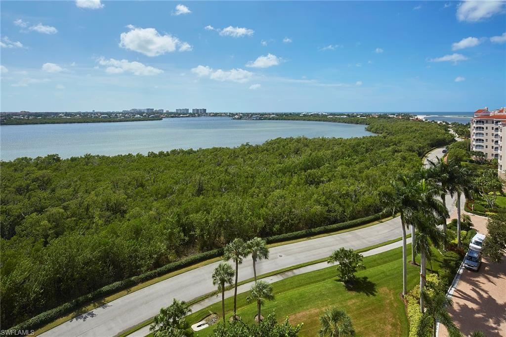 Make this spectacular coastal residence yours, This residence has been fully renovated from top-to-bottom, with an expanded open floor plan offering magnificent Marco Island views in three directions! You will enjoy the watercolor sunsets on the Gulf, the sunrises over Collier Bay & the southern views of the tropical island from this 8th floor, gorgeous end unit! It has travertine & acacia wood flooring, new impact sliders, new gourmet kitchen with Thermador appliances, impressive island, quartz countertops & loads of storage, spacious butler's pantry next to the floor to ceiling windows, solid core doors, beautiful ceiling beams in the living room, spacious master bedroom suite with expansive closet and gorgeous master bath with luxury wall coverings, 2 lovely guest suites, bar area with artistic mosaic, Control 4 system that may easily be transformed into a Smart Home, all new mechanicals, both re-wired & re-plumbed! World class country club lifestyle: fine & casual dining, fitness center, exercise classes, golf course, tennis courts, bocce, beachside community pool & clubhouse!
