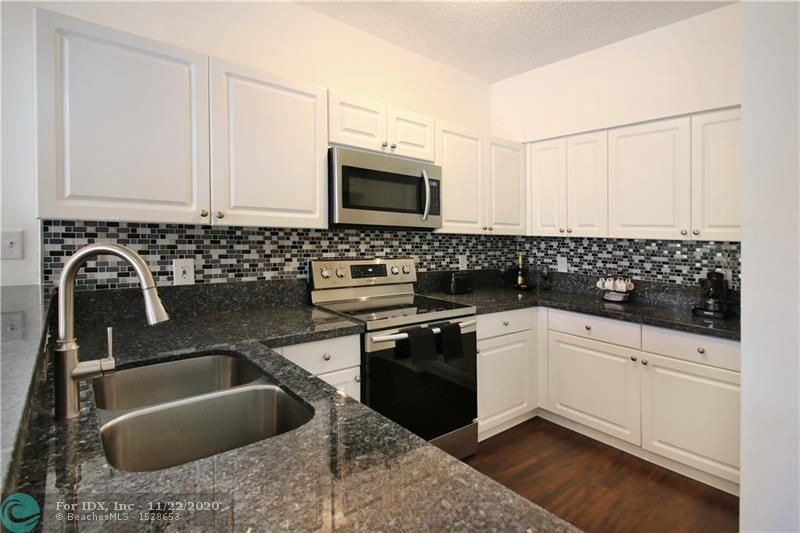 BEAUTIFUL 3 Bed 2.5 Bath Townhouse in the Gated Community of Victoria Isles. Dark Textured Laminated Flooring throughout. Stainless Steel Appliances with Granite Counter tops with new white cabinets and gorgeous blue glass back splash. Community Pool within walking distance. HURRICANE SHUTTERS.