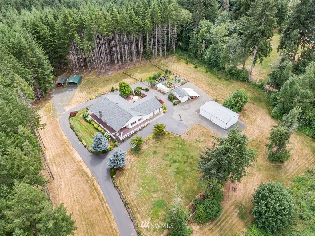 Country living at its best! Don't miss this beautiful 3 bed, 1.75 bath, 2268 sq/ft rambler proudly situated on shy 5 acres in coveted Adna. Too many features to list including; Newer Roof, Vinyl Windows, Cedar Siding, Composite Decking, Heat Pump, Oak Hardwoods, Updated Kitchen & Bathrooms w/Oak Cabinets & Granite Counters, Newer Stainless Appliances, Wood Burning Stove, Utility Room, Jack & Jill Bath, Large Garage, Tons of Storage, and the list goes on. Most of the acreage is level w/ a slight slope and has a circular drive. There's also a large shop, multiple outbuildings, greenhouses, impressive gardens, mature fruit tress, and plenty of room for livestock. Close to local shopping, schools and amenities. Hurry today before its too late!